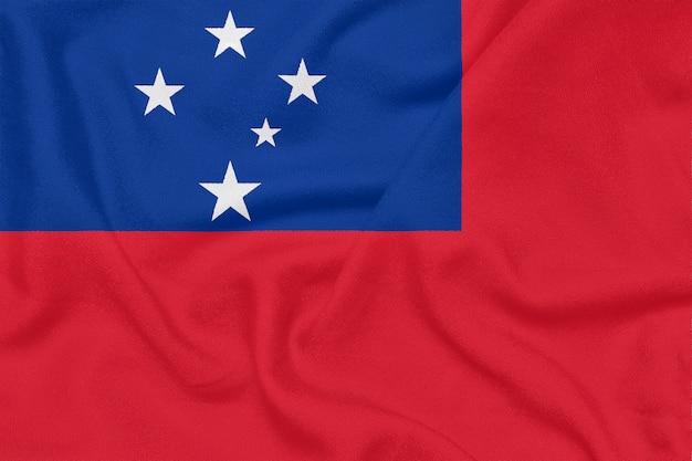Drapeau des samoa sur tissu texturé. symbole patriotique