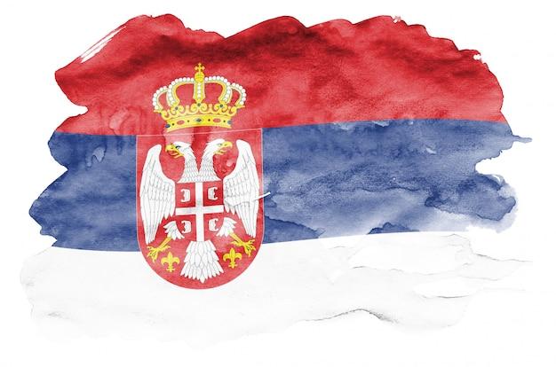 Le drapeau de la serbie est représenté dans un style aquarelle liquide isolé sur blanc