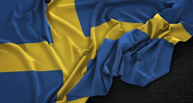 Drapeau suédois enroulé sur fond sombre 3d rendre