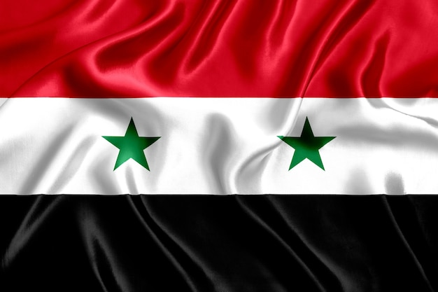 Drapeau de la syrie en gros plan de soie