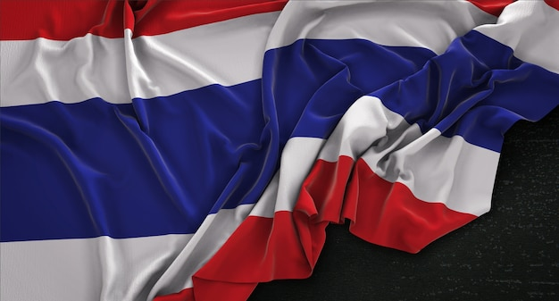Drapeau de la thaïlande enroulé sur fond sombre 3d render