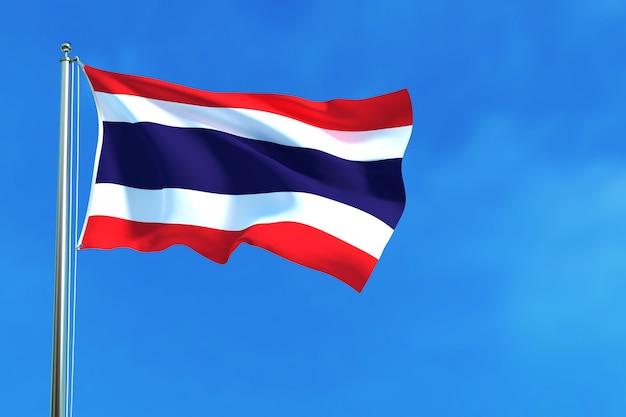 Drapeau de la thaïlande sur le fond de ciel bleu