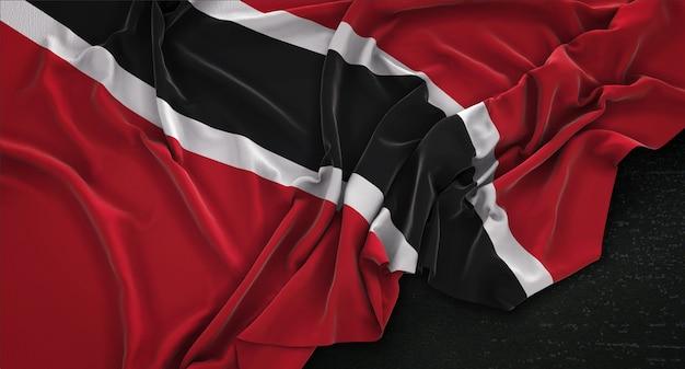 Drapeau de trinité-et-tobago enroulé sur fond sombre 3d render