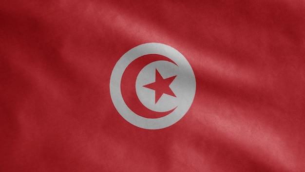 Drapeau tunisien flottant dans le vent. gabarit de la tunisie soufflant, soie douce et lisse. fond d'enseigne de texture de tissu de tissu.