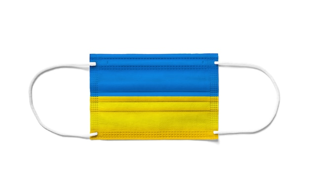 Drapeau de l'ukraine sur un masque chirurgical jetable