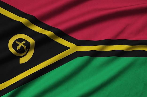 Le drapeau de vanuatu est représenté sur un tissu de sport avec de nombreux plis.