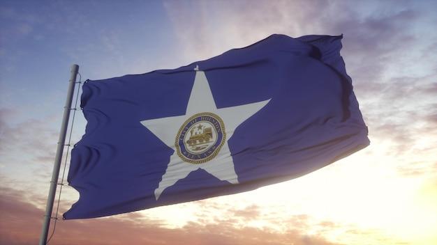 Drapeau de la ville de houston au texas dans le fond du vent, du ciel et du soleil. rendu 3d