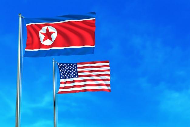 Drapeaux de corée du nord et des états-unis (états-unis) sur le fond de ciel bleu