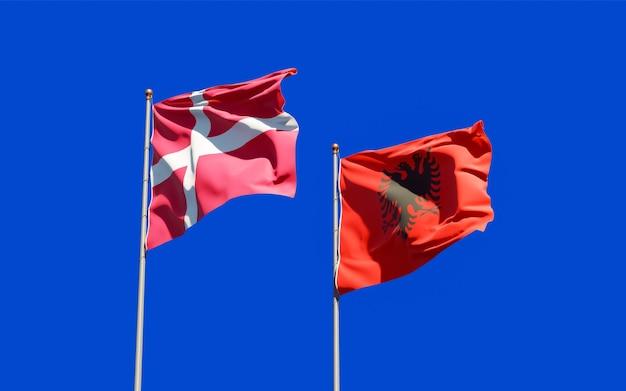 Drapeaux du danemark et de l'albanie. illustration 3d