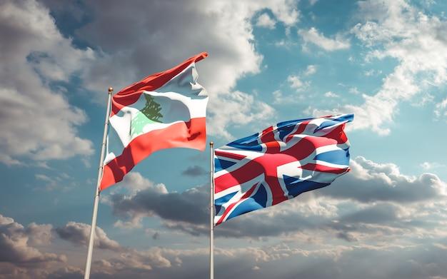 Drapeaux du liban et du royaume-uni britannique sur ciel bleu. illustration 3d