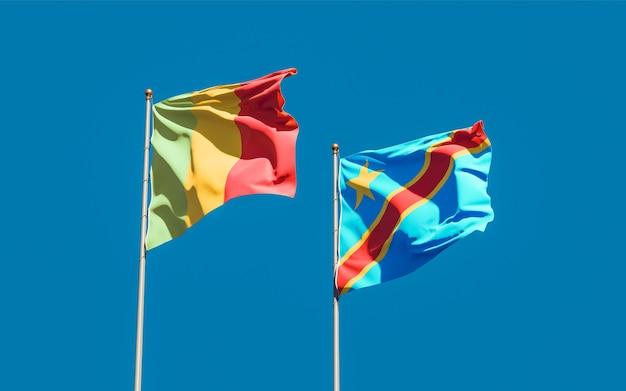 Drapeaux du mali et de la rd congo sur ciel bleu. illustration 3d