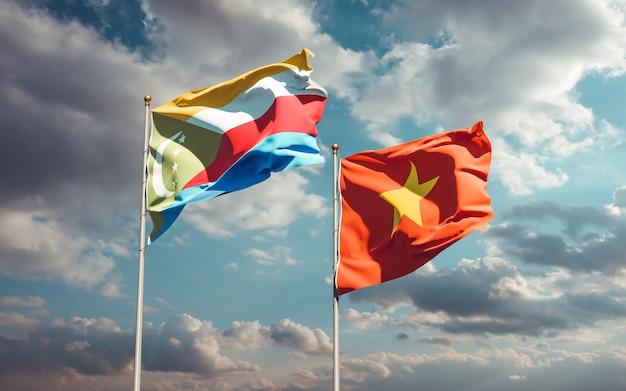 Drapeaux du vietnam et des comores. illustration 3d
