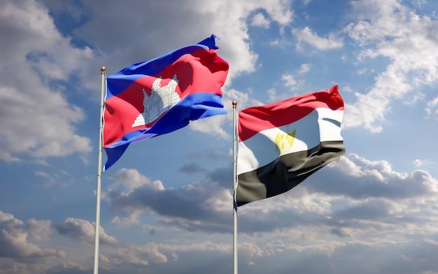 Drapeaux de l'égypte et du cambodge. illustration 3d