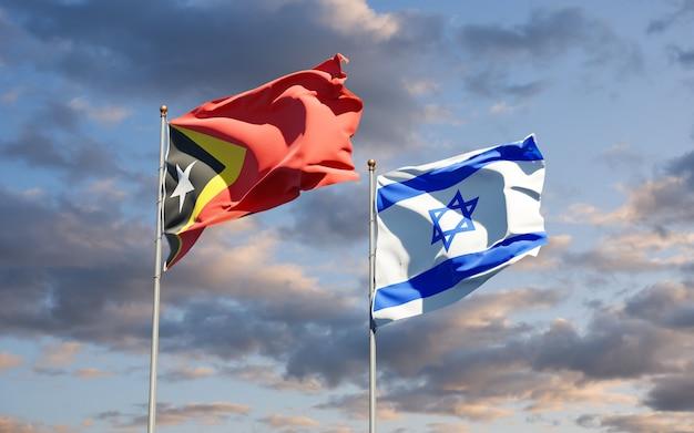 Drapeaux d'état du timor oriental et d'israël ensemble sur fond de ciel