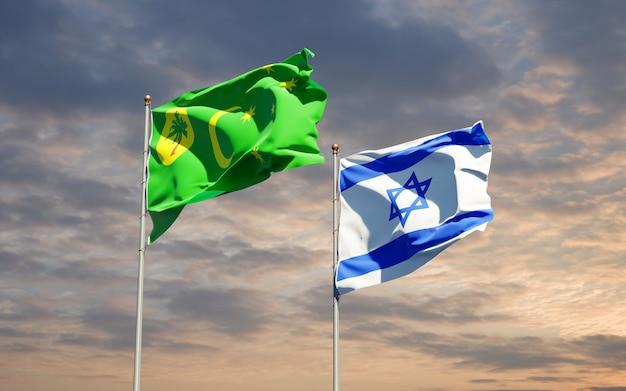 Drapeaux d'état d'israël et de l'île cocos ensemble sur fond de ciel