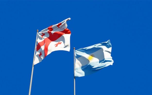Drapeaux de la géorgie et de l'argentine. illustration 3d