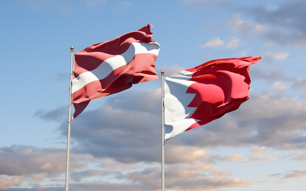Drapeaux de la lettonie et de bahreïn. illustration 3d
