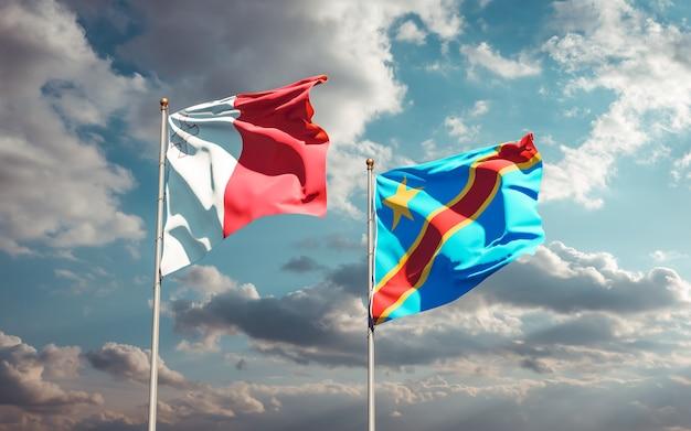 Drapeaux de malte et de la rd congo sur ciel bleu. illustration 3d