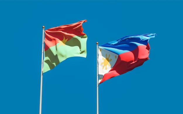 Drapeaux des philippines et du burkina faso. illustration 3d