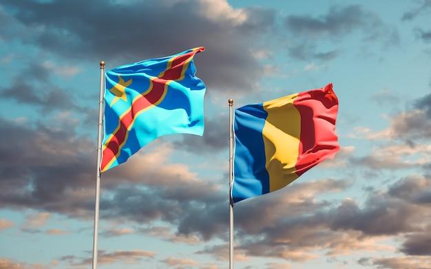 Drapeaux de la roumanie et de la rd congo sur ciel bleu. illustration 3d