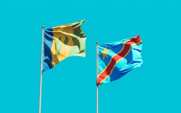 Drapeaux de saint vincent et les grenadines et rd congo sur ciel bleu. illustration 3d