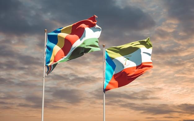 Drapeaux des seychelles et de la guinée équatoriale sur fond de ciel