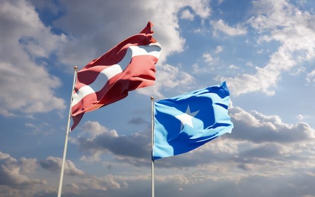 Drapeaux de la somalie et de la lettonie. illustration 3d