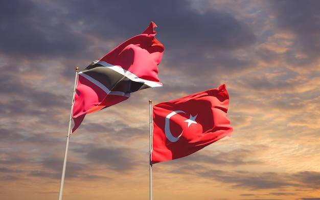 Drapeaux de trinité-et-tobago et de la turquie sur fond de ciel
