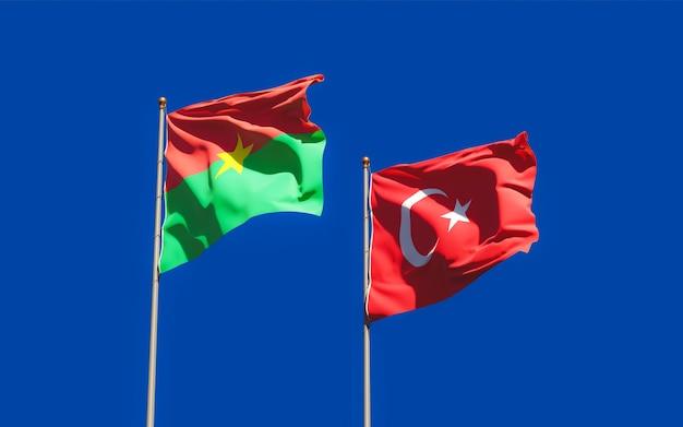Drapeaux de la turquie et du burkina faso. illustration 3d