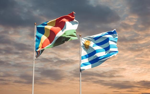 Drapeaux de l'uruguay et des seychelles. illustration 3d