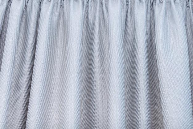 Draperie grise, rideaux plissés. fond, concept de texture.