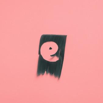 E une lettre verte feuille tropicale alphabet rose