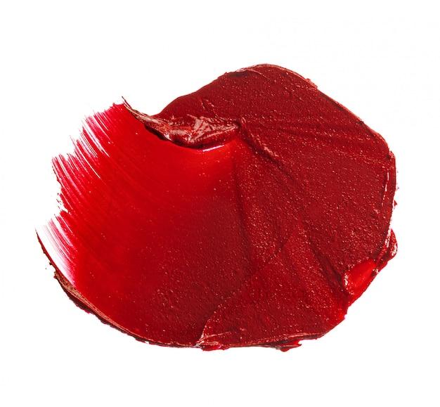 Échantillon de nuance de rouge à lèvres sur blanc. fermer.