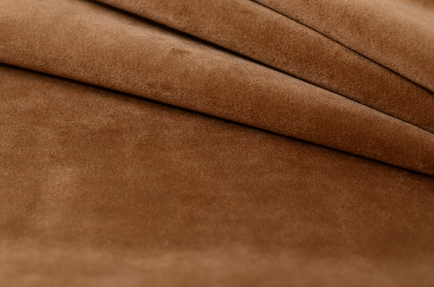 Échantillon de textile en velours marron. fond de texture de tissu