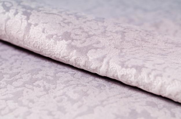 Échantillons de textiles en velours beige. texture de tissu