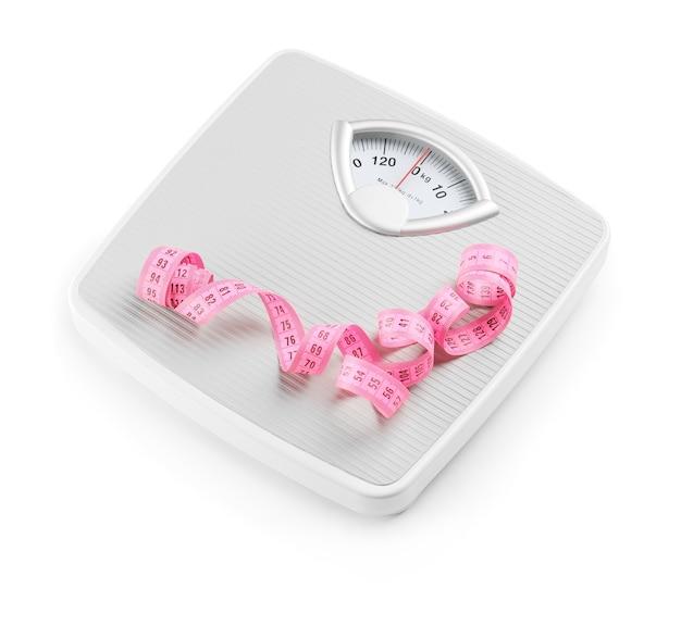 Échelles de poids avec ruban à mesurer. concept minceur