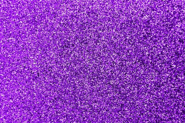 Éclaboussure de paillettes et lumière parasite sur violet brillant tendance