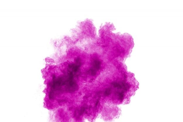 Éclaboussures de particules roses sur fond blanc