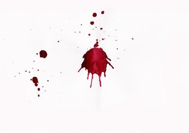 Éclaboussures de sang sur fond blanc