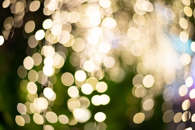 Éclairage arbre de noël flou focus comme arrière-plan bokeh