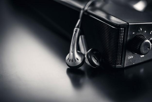 Écouteur avec haut-parleur