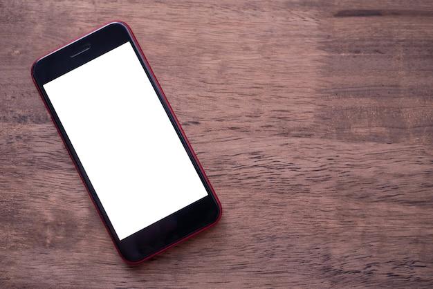 Écran en gros plan maquette téléphone mobile sur un plancher en bois