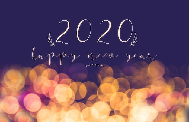 Écriture manuscrite 2020 bonne année vintage flou bokeh fond clair