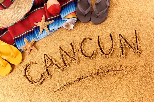 Écriture sur la plage de cancun