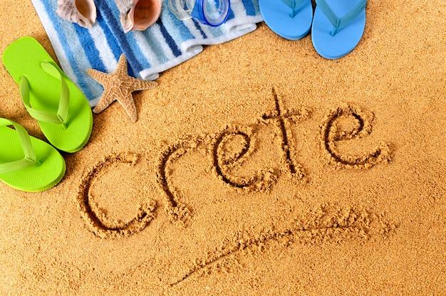 Écriture de plage en crète