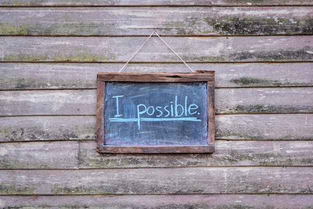 Efface l'impossible sur tableau noir à possible