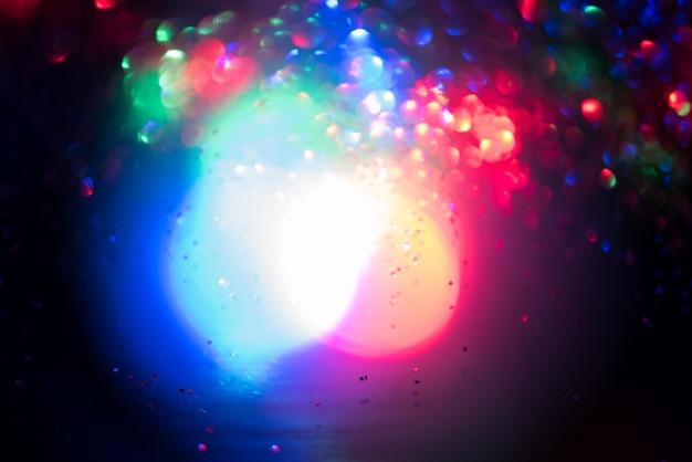 Effet d'éclairage de bokeh de paillettes colorfull abstrait flou