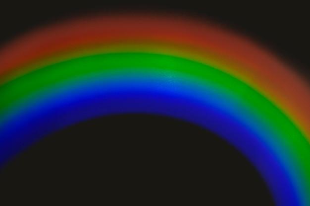 Effet de fuite de lumière en demi-cercle sur un papier peint noir