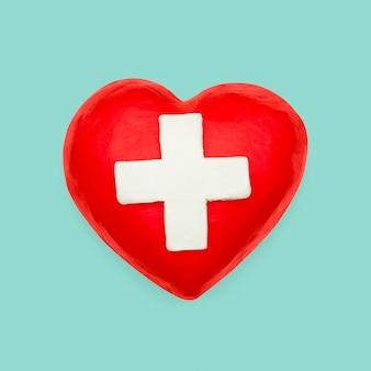 Élément de bricolage en pâte à modeler coeur croix médicale
