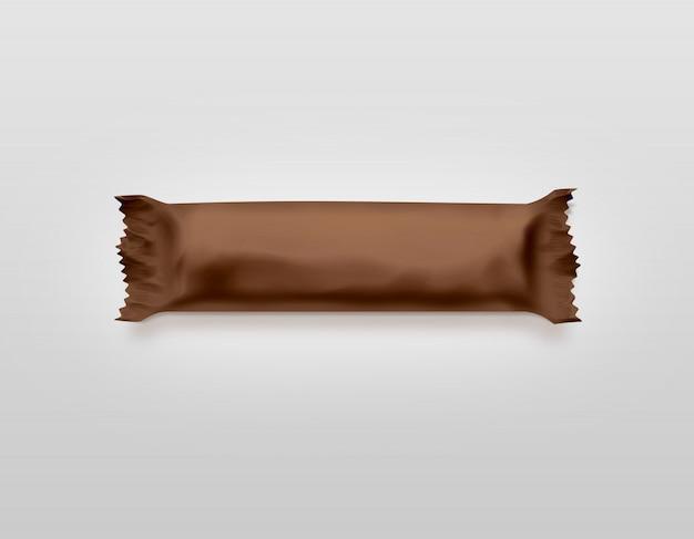 Emballage en plastique de barre de bonbons brun blanc isolé